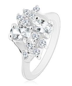 Inel argintiu cu brațe înguste, oval transparent și zirconii rotunde