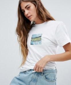 Vans - Weißes T-Shirt mit Cartoon-Print auf dem Rücken - Weiß