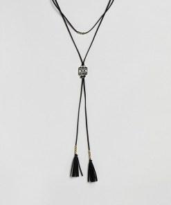 ASOS DESIGN - Gewickelte Boho-Halskette aus Wildleder in schwarz-Weiß - Schwarz