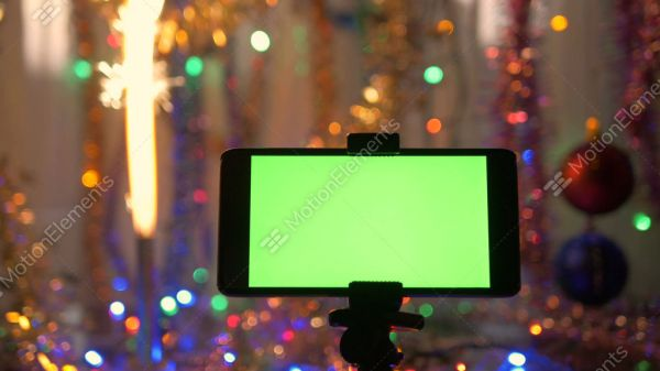 Smartphone With A Green Screen, On A New Year's Background ...