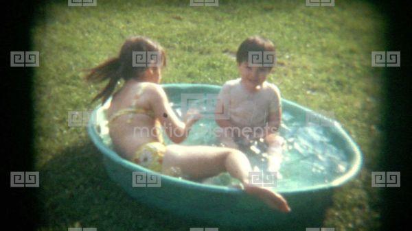 Vintage Film Kids Play In Kiddie Pool Stock video footage ...
