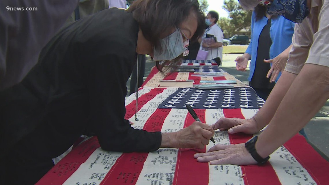 , Survivors of World War II internment camps sign American flags at Arvada ceremony, Nzuchi Times National News