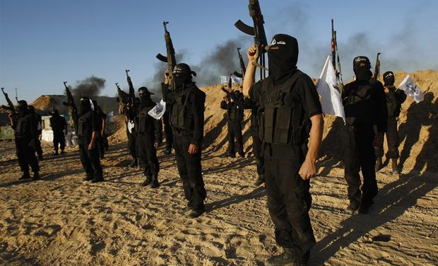 Palestinian militants from Al-Ansar brigade take part in a training session in Khan Younis in the southern Gaza Strip