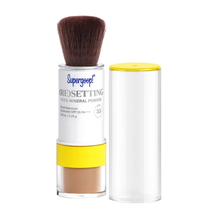 An open tube of Supergoop (Re)setting 100% Mineral Powder SPF 35 on white background