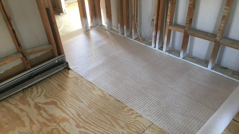 laying tile over uncoupling membrane