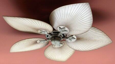 How to Install a Ceiling Fan Remote   Angie s List Ceiling fan with palm style blades on a dark pink ceiling