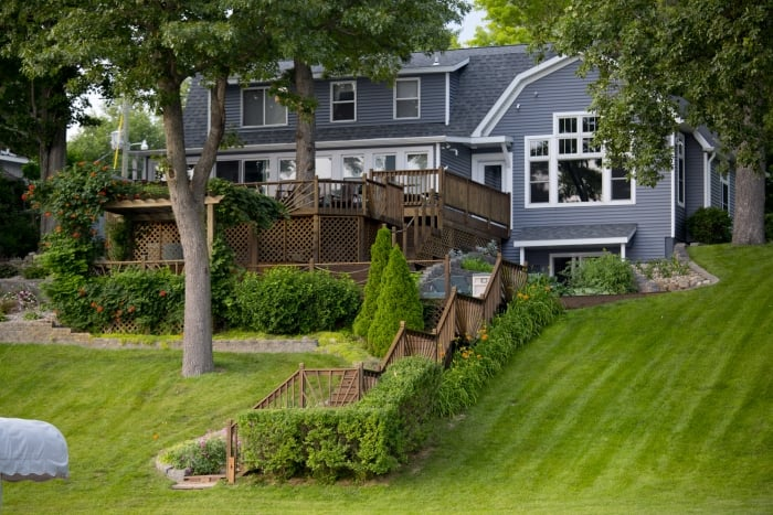 What are the Challenges of Landscaping a Lakefront Home ... on Lakefront Patio Ideas id=96319