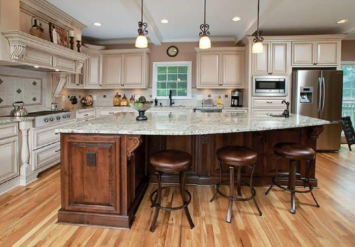 Bar Stools or Chairs for Kitchen Island Seating    Angie s List large granite countertop covered kitchen island with leather chair height  stools