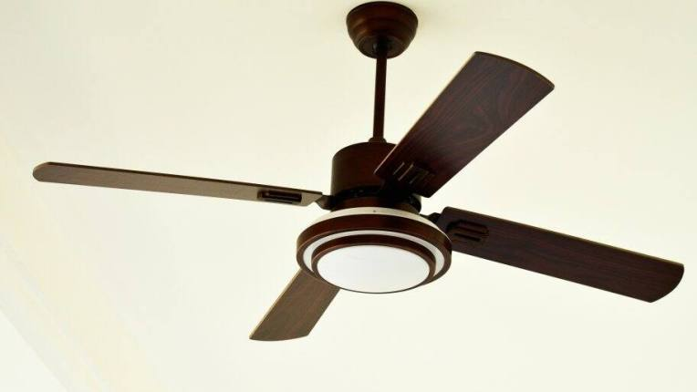 How to Install a Ceiling Fan Remote   Angie s List Modern ceiling fan with rubbed bronze hardware and dark wood blades on  off white ceiling