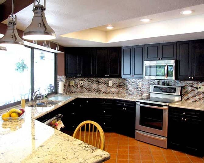 Dark Maple Kitchen Cabinets with Alaska Gold Granite ... on Maple Kitchen Cabinets With Black Granite Countertops  id=51570