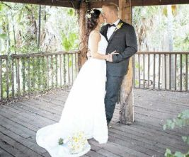 JUST MARRIED: Jessica and Jeremy Dennien share a kiss after their wedding.