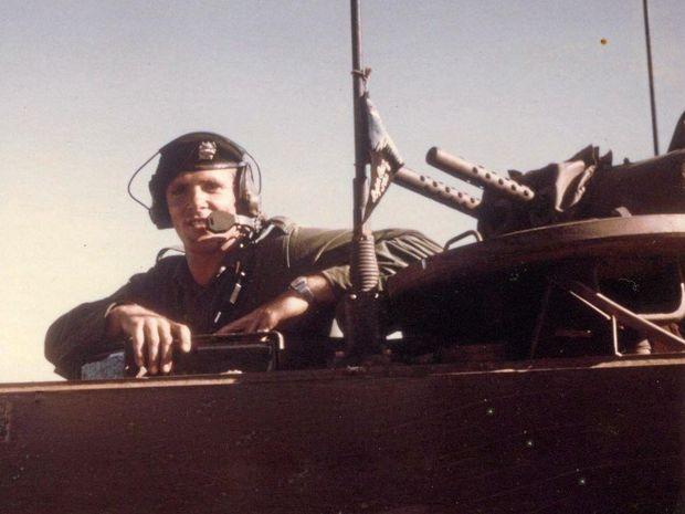 BYRON BOY: President of the Byron Bay RSL Sub Branch, Robert Asquith, as a troop carrier driver in Vietnam. Look closely on the radio antenna and you can see the Byron Bay flag he flew the whole time he was in Vietnam. Photo courtesy Rob Asquith