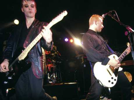 Richey Edwards and James Dean Bradfield performing live onstage.