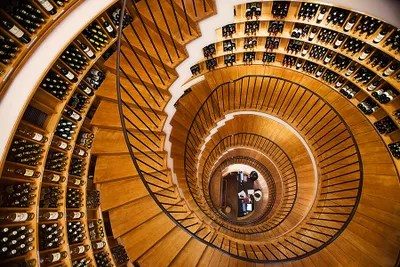 A bottlelined spiral staircase at one of Bordeauxs premier wine shops LIntendant.     2 alle de Tourny 33556480129...