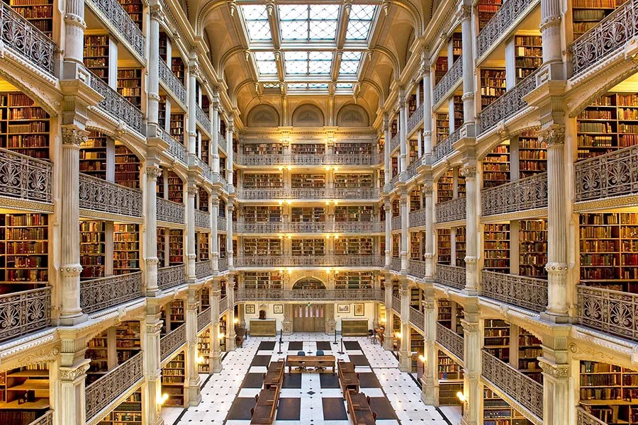The Peabody Library, which opened in 1878, was designed by Baltimore architect Edmund G. Lind, in collaboration with John Hopkins' first provost, Nathaniel H. Morison. Rising 61 feet, the central atrium features five tiers of cast-iron balconies, creating a dramatic effect.
