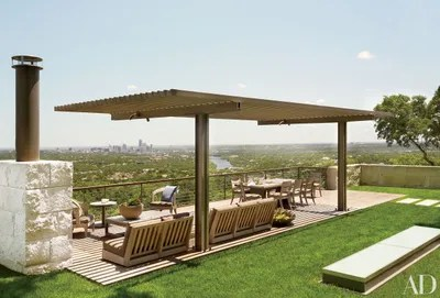 the style of this steel pergola at an austin house complements the design of the ipewood