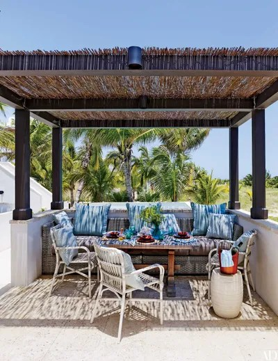 a pergola doesn t need to be an expensive addition designer tom scheerer roofed