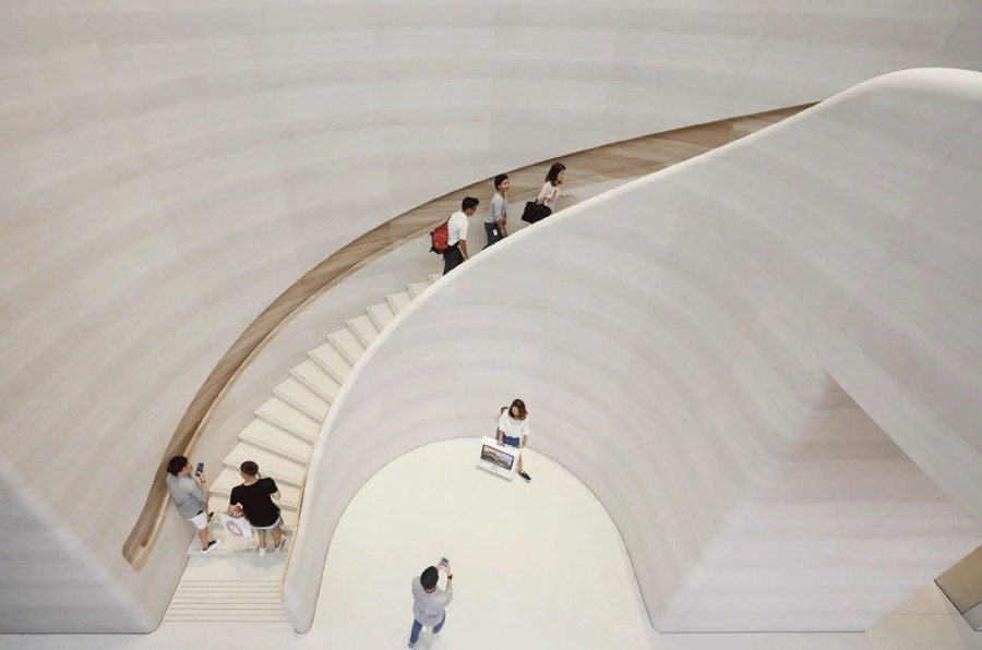 Image may contain Banister Handrail Human Person Staircase Clothing and Apparel