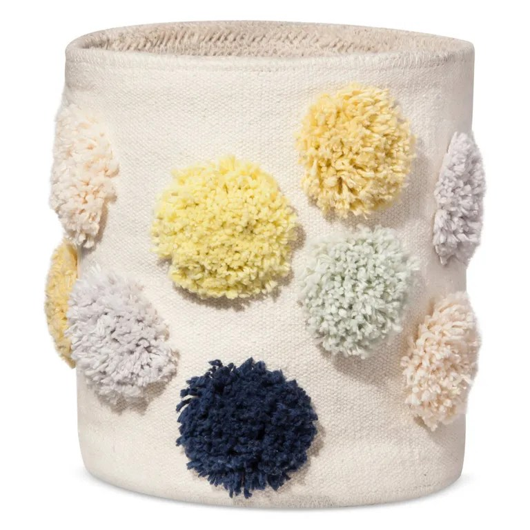 Frilly cotton pom-poms liven up this fabric catch-all—just one of many must-buys from Target's new line by Nate Berkus. SHOP NOW: Pom Pom Bin by Nate Berkus, $15, target.com