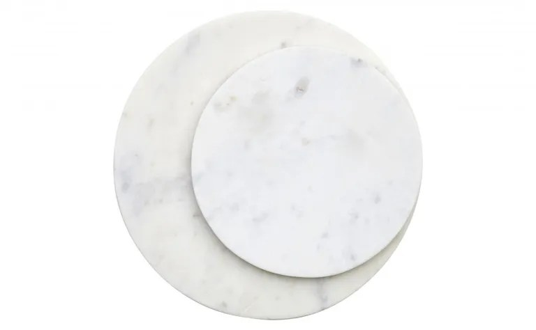 "A simple, perfect circle of marble can be so many things: a cheese board, a bar gear holder, a place to set your pot right on the table. SHOP NOW: 8"" Round Marble Board by Jayson Home, $25, jaysonhome.com"