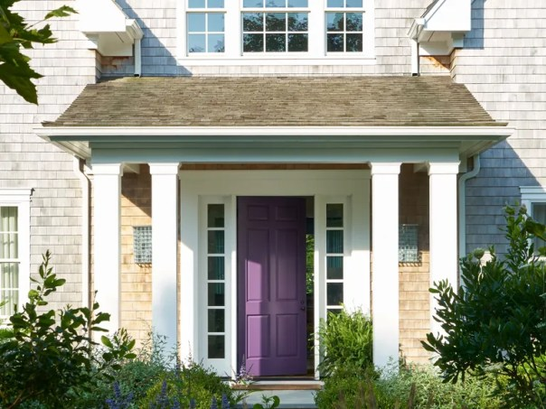 """""""The homeowner loves color,"""" says Manhattan-based interior designer Timothy Brown of a Connecticut couple's shingled home in Amagansett, New York. To set the tone for the unexpected beach house beyond the façade, he coated the front door in a lively shade of purple by Benjamin Moore."""