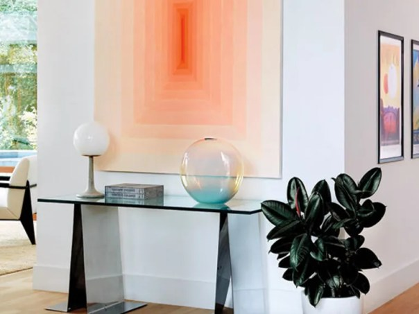 A lamp by Schoolhouse Electric & Supply Co. and a glass sculpture by John Hogan] for The Future Perfect top a vintage Maison Raphael console in the entry; painting by Corydon Cowansage