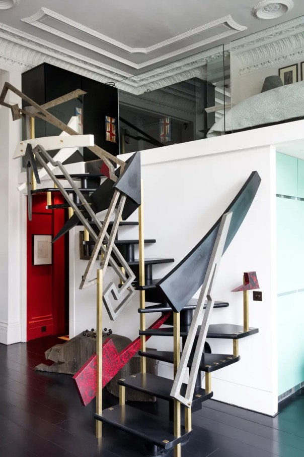 The fabulous bronze staircase plays a part in adding theatre, space, and light. It's a piece of art. Keeping the original stair treads, Bolan added the bronze shapes, sculpting the piece very much in the manner of American furniture designer Paul Evans.