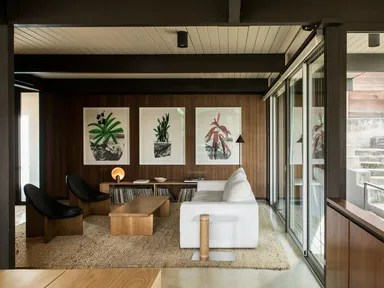living room with paneled walls and ceiling, plus sliding glass doors