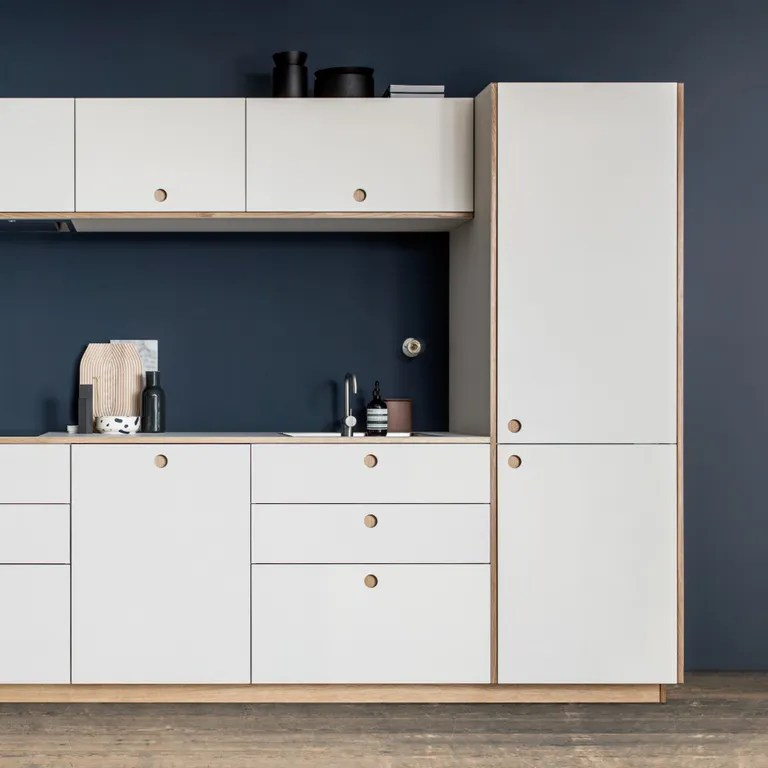 These Are the Best Fronts for IKEA Kitchen Cabinets   Architectural     white cabinets with centered finger pulls in blue kithchen