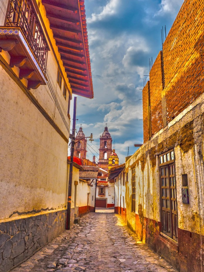 Cobblestone Street in mexico on partly cloudy day
