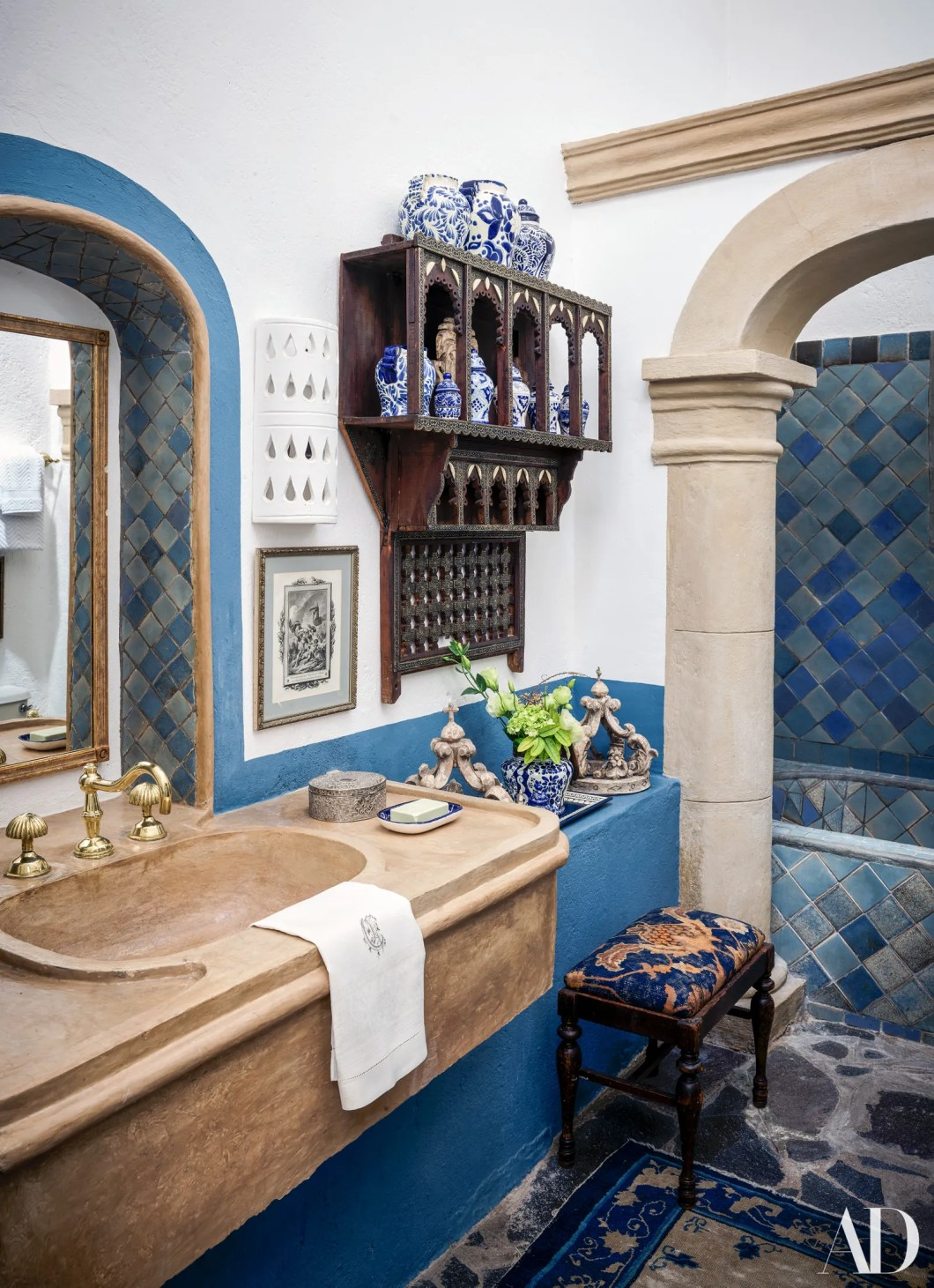 A bathrooms sink and tub are custom. Vintage terracotta sconces from Tajan.