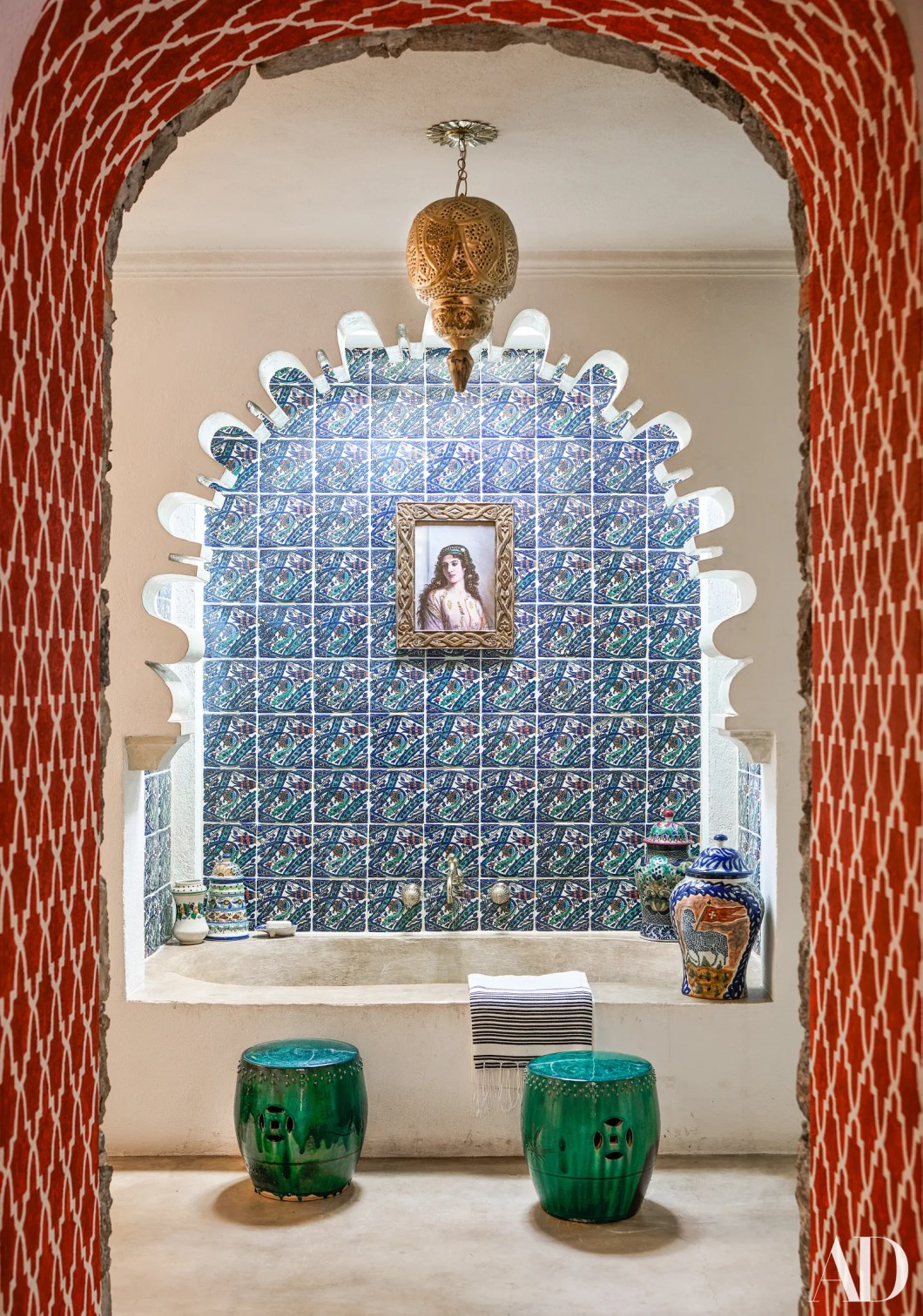 A 19thcentury painting hangs over the custom polishedconcrete tub. Tiles by Nussbaumer.
