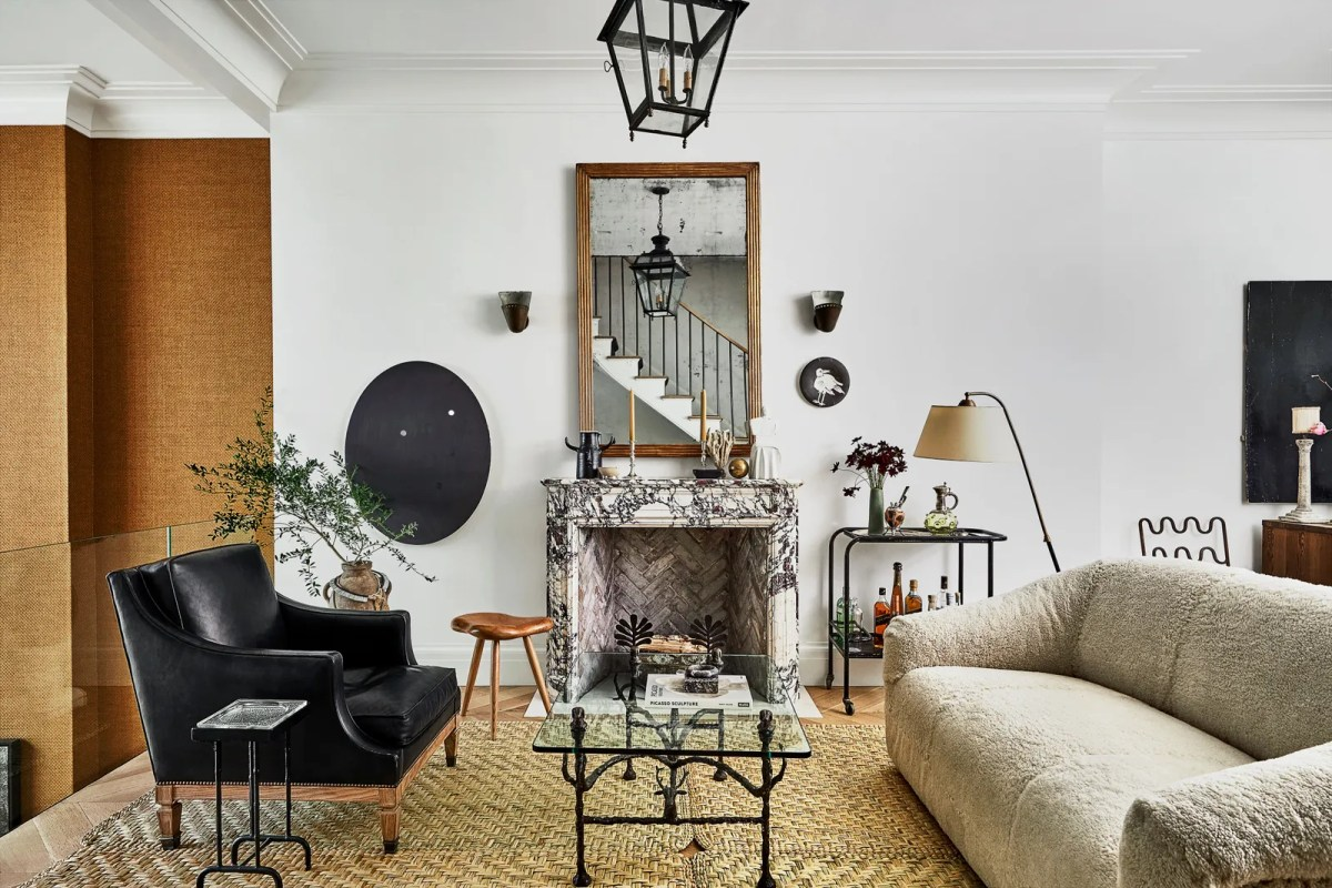 In a sitting area a 1940's armchair and shearlingcovered sofa surround the 1960's cocktail table by Diego Giacometti....