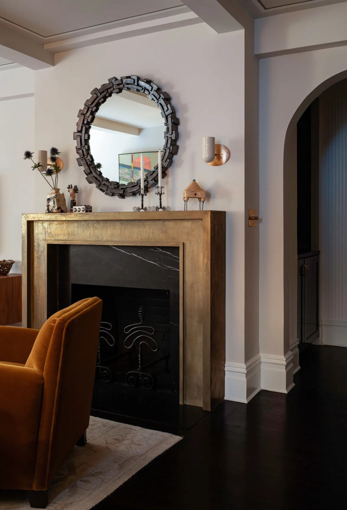 A bronze mantle and gunmetal mirror