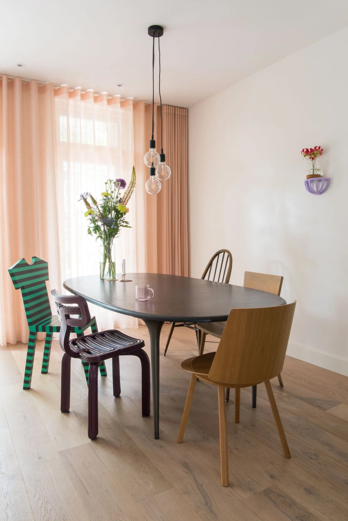 The funky striped chairs by Annette Philip resemble Tshirts when tucked under the dining room tableit almost looks as if...