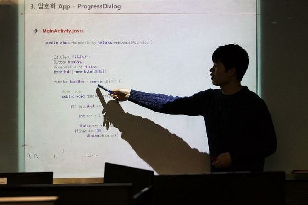 an-instructor-points-to-a-line-of-code-in-the-programming-language-java-displayed-on-a-projection-screen-during-a-cyber-defense-programming-class-in-the-war-room-at-korea-university-in-seoul-south-korea-last-week