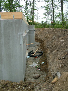 Believe it or not, this is a precast foundation wall. It is made from poured concrete and rests on compacted gravel, not a poured concrete footer. If this wall was backfilled before the interior floor was poured, it would collapse in no time. PHOTO BY: Tim Carter