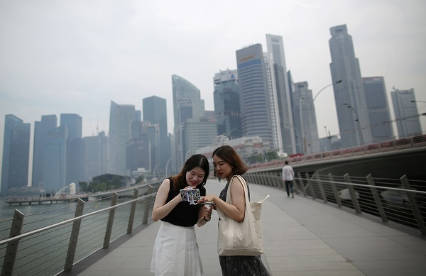 Singapore has a three-pronged retirement system called the Central Provident Fund, to which all Singaporeans and their employers contribute. (Photo: AP)