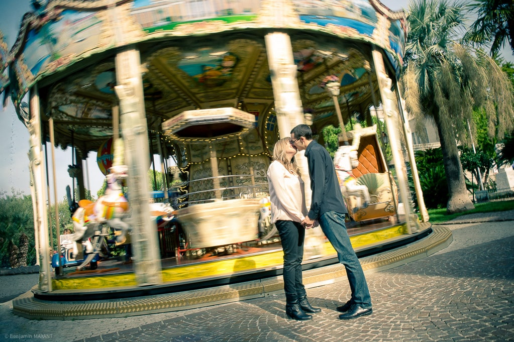Couple engagement photo shoot next to a carousel