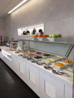 AA's renovated Admirals Club at CLT includes a more modern food bar that's complimentary to members.