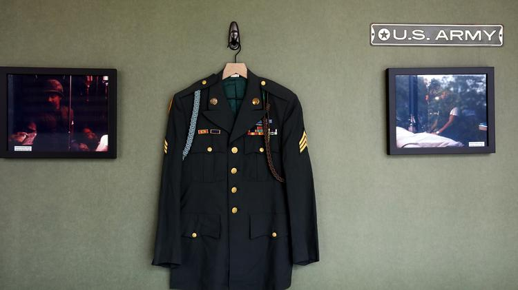 The uniform of Michael Lynd hangs on a wall at Lynd Co. as it's displayed with other items from men that served with Lynd during the Vietnam War.