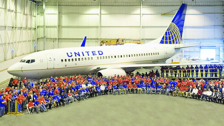 Hundreds of North State Aviation workers gather in front of a United Airlines plane at the company's Smith Reynolds Airport facility in Winston-Salem. Many of North State Aviation's employees previously worked at Piedmont Airlines, a once dominant air carrier.