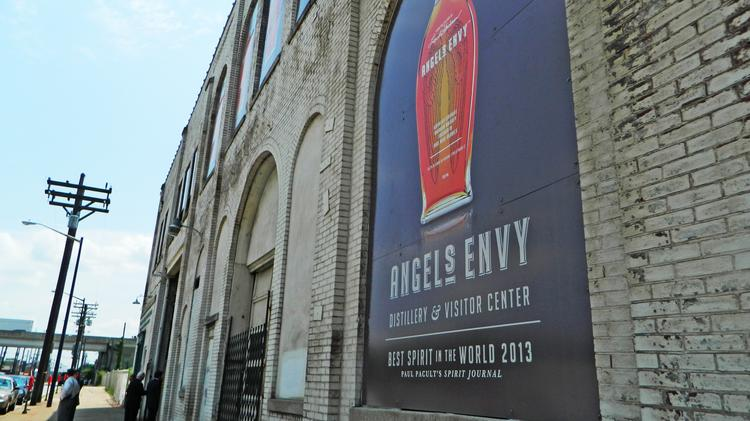 Angel's Envy is planning a distillery and tourist destination across from Slugger Field. The widow of the bourbon creator is suing her son over proceeds from a sale to Bacardi Ltd.