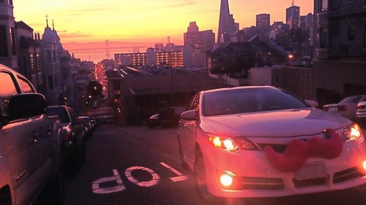 Lyft car making its way up a hill in San Francisco.