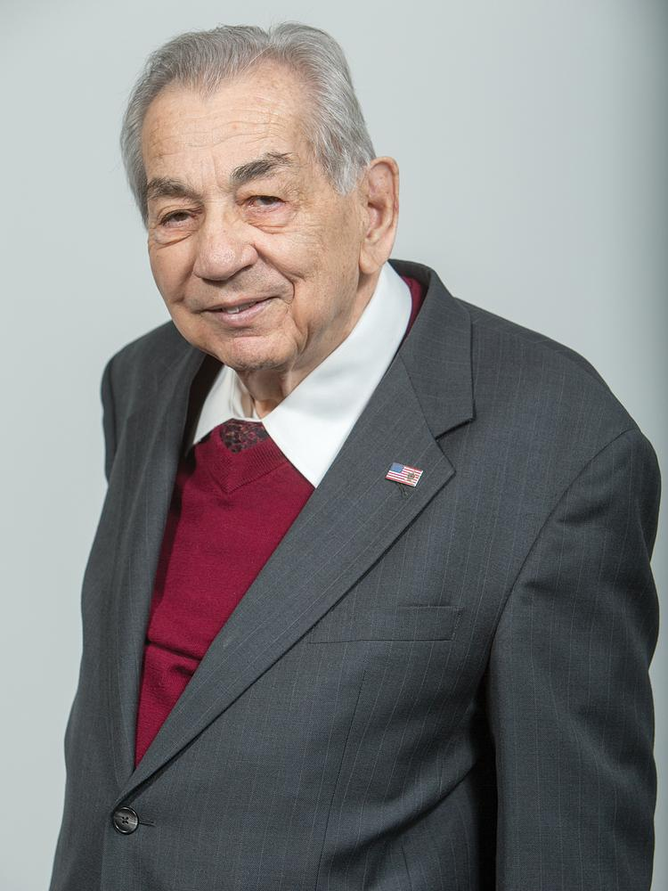 Ernie Garfield, a consultant to Scottsdale Community Bank who has been instrumental in starting 32 banks.