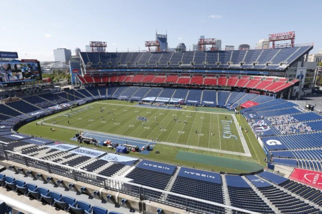 Players warm up with no fans in the stadium before an NFL football game between the Tennessee Titans and the Jacksonville Jaguars Sunday, Sept. 20, 2020, in Nashville, Tenn. (AP Photo/Wade Payne)
