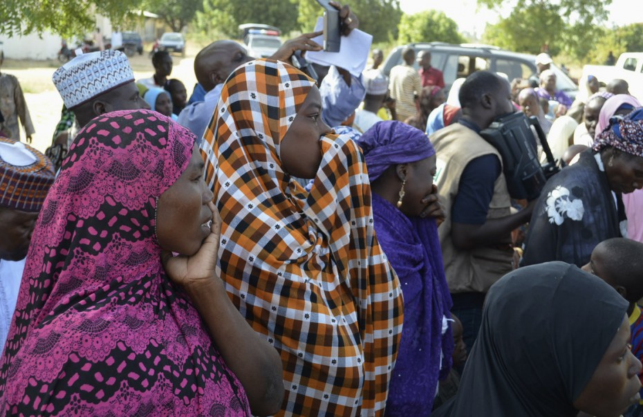 Photo: Reuters. Families of kidnapped schoolgirls attend a meeting with the local government in the remote town of Chibok, Nigeria.