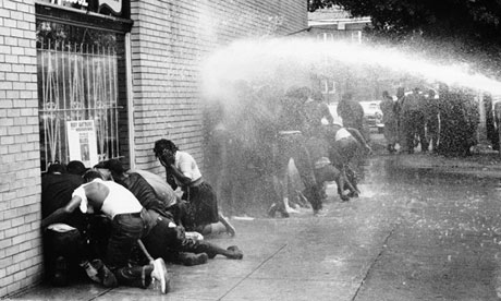 American civil rights protestors are attacked with a water cannon, 1963. Photograph: Getty Images