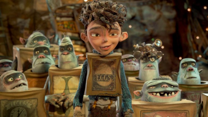 Eggs (center, voiced by Isaac Hempstead Wright) is surrounded by his Boxtroll friends in  LAIKA and Focus Features' family event movie THE BOXTROLLS, opening nationwide  September 26th.  Credit: LAIKA, Inc. / Focus Features