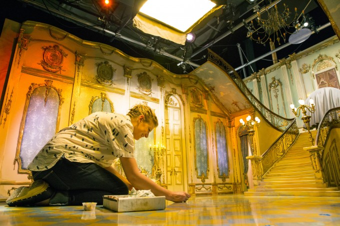 Caitlin Pashalek works on the floors in Lord Portley-Rind's house during production of  LAIKA and Focus Features' family event movie THE BOXTROLLS, opening nationwide  September 26th.  Credit: John Leonhardt / LAIKA, Inc.